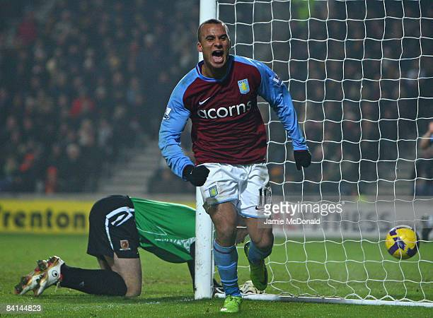 Gabriel Agbonlahor of Aston Villa celebrates after Kamil Zayatte of Hull City scored an own goal during the Barclays Premier League match between...
