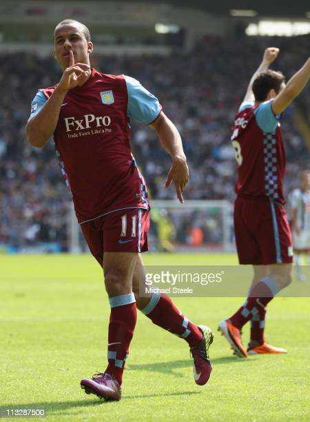 Gabriel Agbonlahor of Aston Villa celebrates in front of the home fans after an own goal scored by Abdoulaye Meite puts Villa in the lead during the...