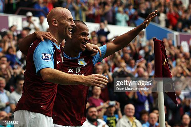 Gabriel Agbonlahor of Aston Villa celebrates scoring the first goal of the game with James Collins during the Barclays Premier League match between...