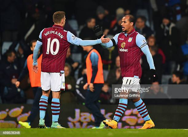 Gabriel Agbonlahor of Aston Villa celebrates with Andreas Weimann as he scores their first goal during the Barclays Premier League match between...