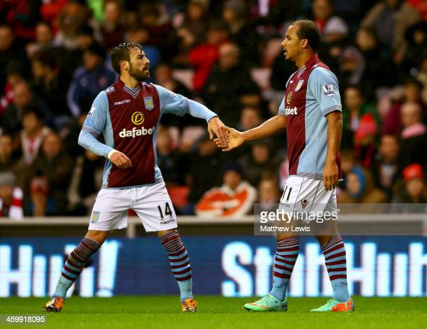 Gabriel Agbonlahor of Aston Villa celebrates with Antonio Luna as he scores their first goal during the Barclays Premier League match between...