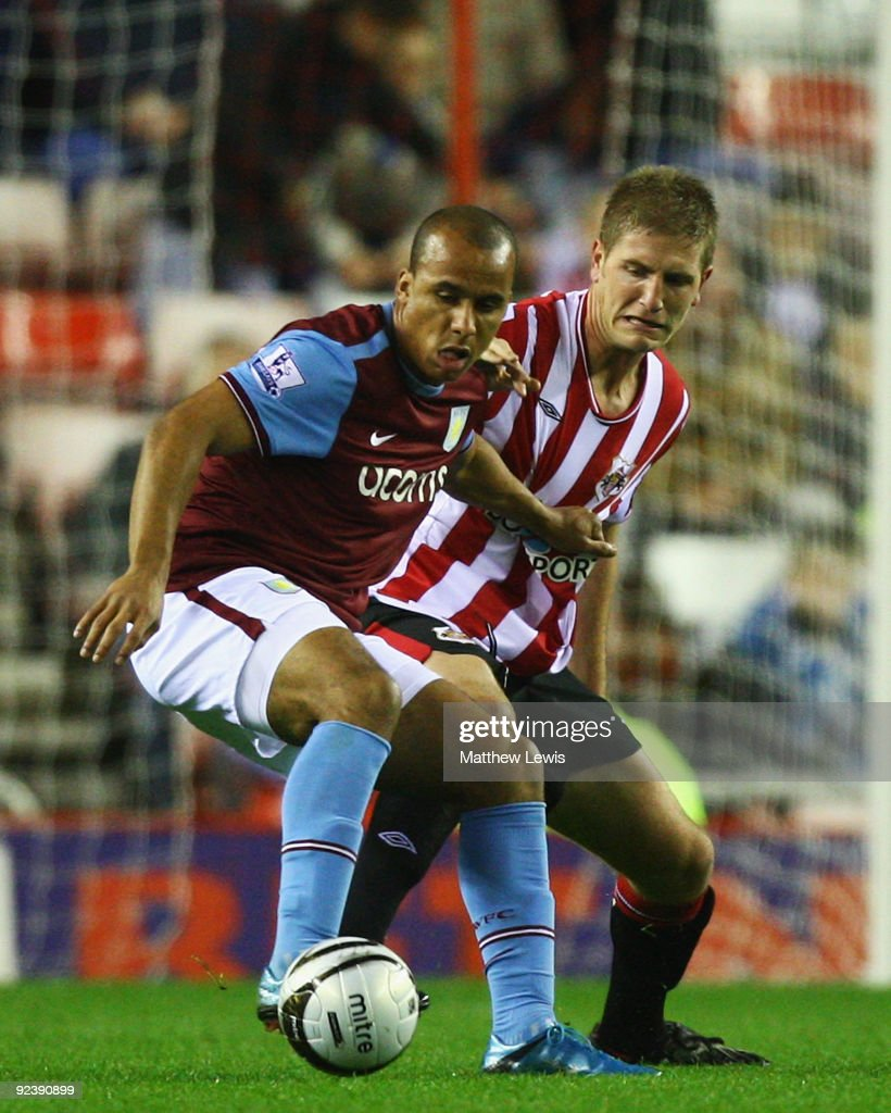 Gabriel Agbonlahor (L) of Aston Villa holds off Michael Turner of Sunderland during the Carling Cup 4th Round match between Sunderland and Aston Villa at the Stadium of Light on October 27, 2009 in Sunderland, England.