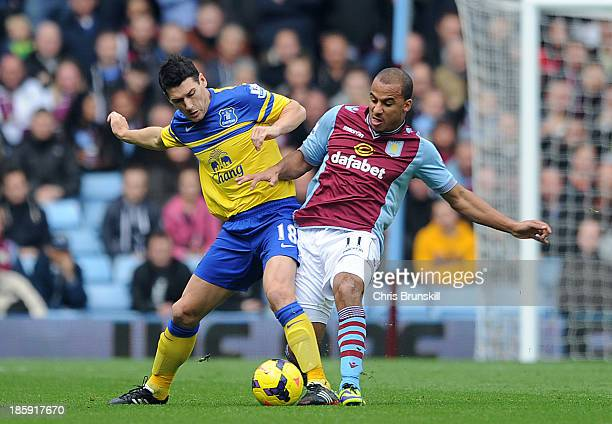 Gabriel Agbonlahor of Aston Villa in action with Gareth Barry of Everton during the Barclays Premier League match between Aston Villa and Everton at...