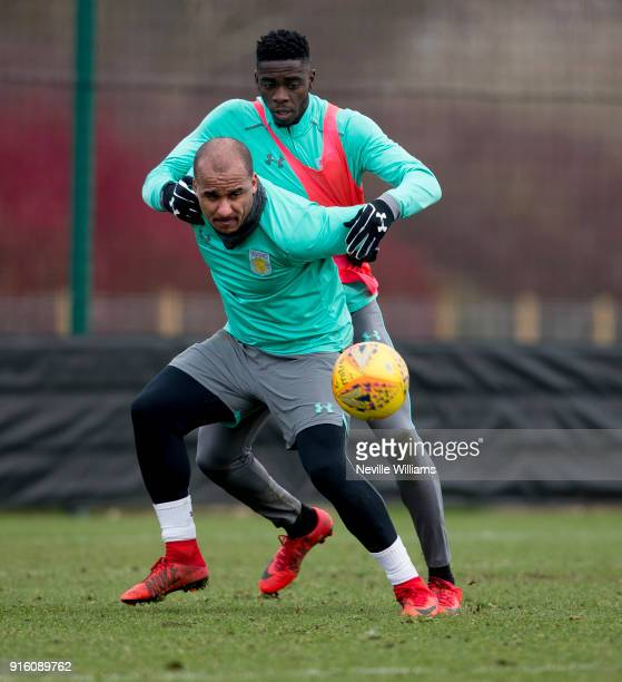 Gabriel Agbonlahor of Aston Villa in action with team mate Axel Tuanzebe during a Aston Villa training session at the club's training ground at...
