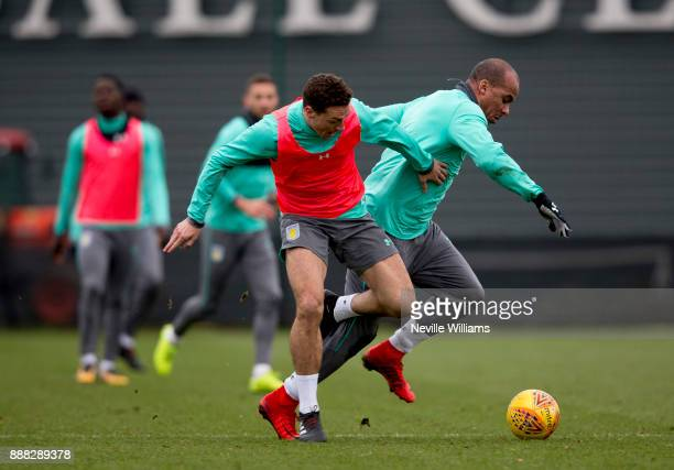 Gabriel Agbonlahor of Aston Villa in action with team mate James Chester during a training session at the club's training ground at Bodymoor Heath on...