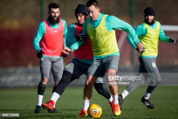 Gabriel Agbonlahor of Aston Villa in action with team mate John Terry during a Aston Villa training session at the club's training ground at Bodymoor...