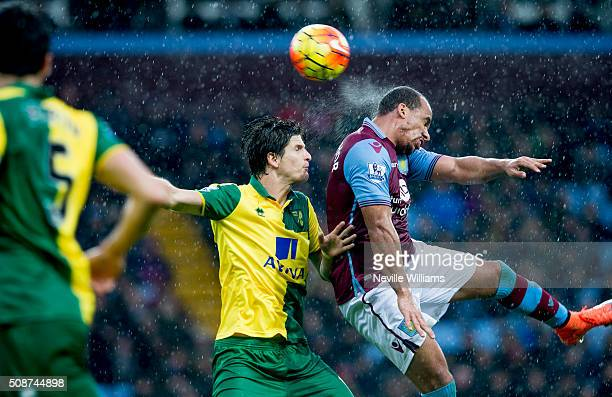 Gabriel Agbonlahor of Aston Villa is challenged by Jonny Howson of Norwich City during the Barclays Premier League match between Aston Villa and...
