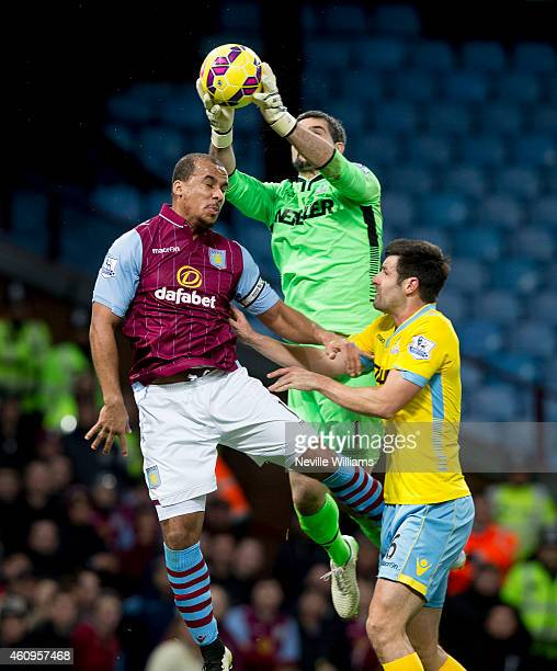 Gabriel Agbonlahor of Aston Villa is challenged by Julian Speroni of Crystal Palace during the Barclays Premier League match between Aston Villa and...