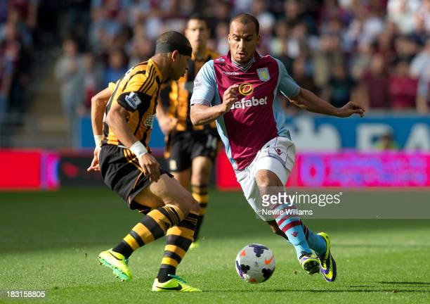 Gabriel Agbonlahor of Aston Villa is challenged by Liam Rosenior of Hull City during the Barclays Premier League match between Hull City and Aston...