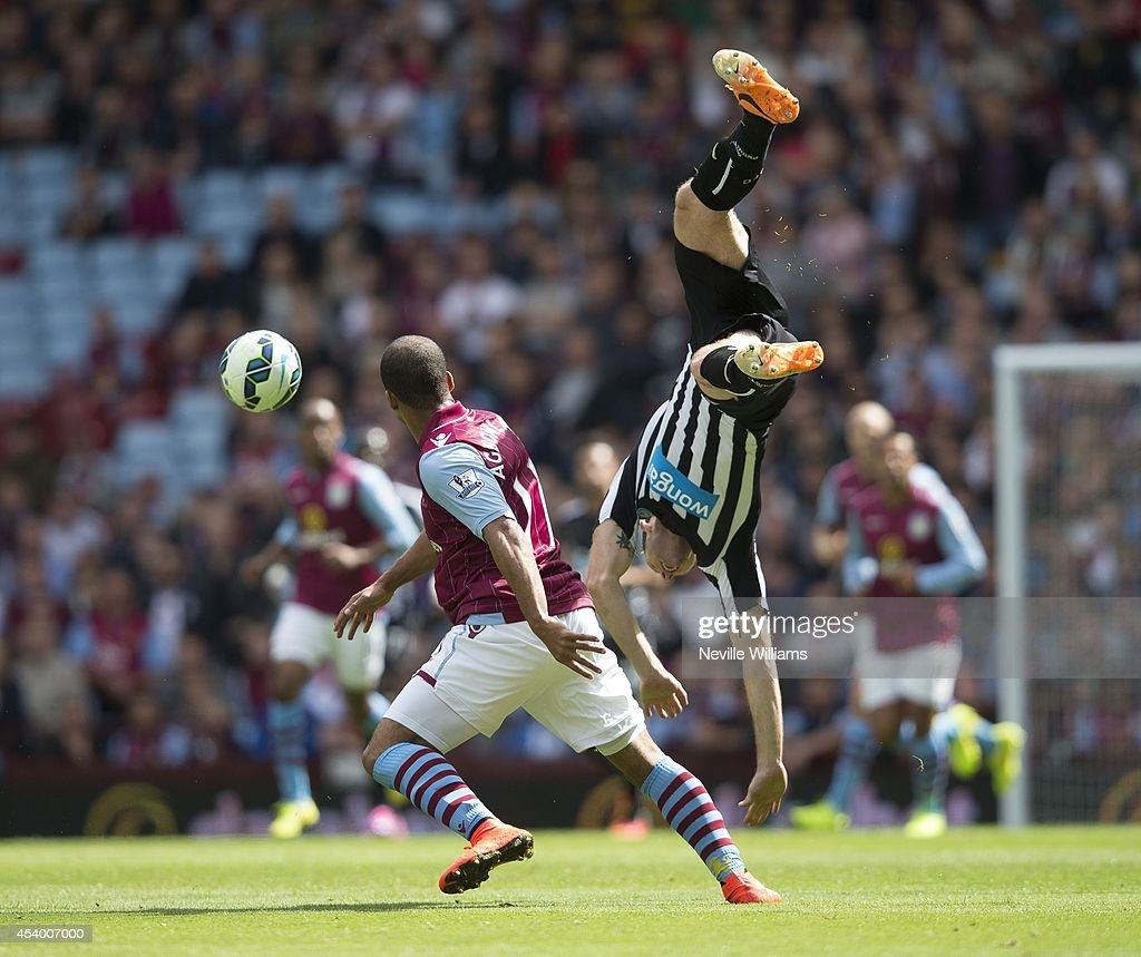 Gabriel Agbonlahor (L) of Aston Villa is challenged by Mike Williamson of Newcastle United during the Barclays Premier League match between Aston Villa and Newcastle United at Villa Park on August 23, 2014 in Birmingham, England.