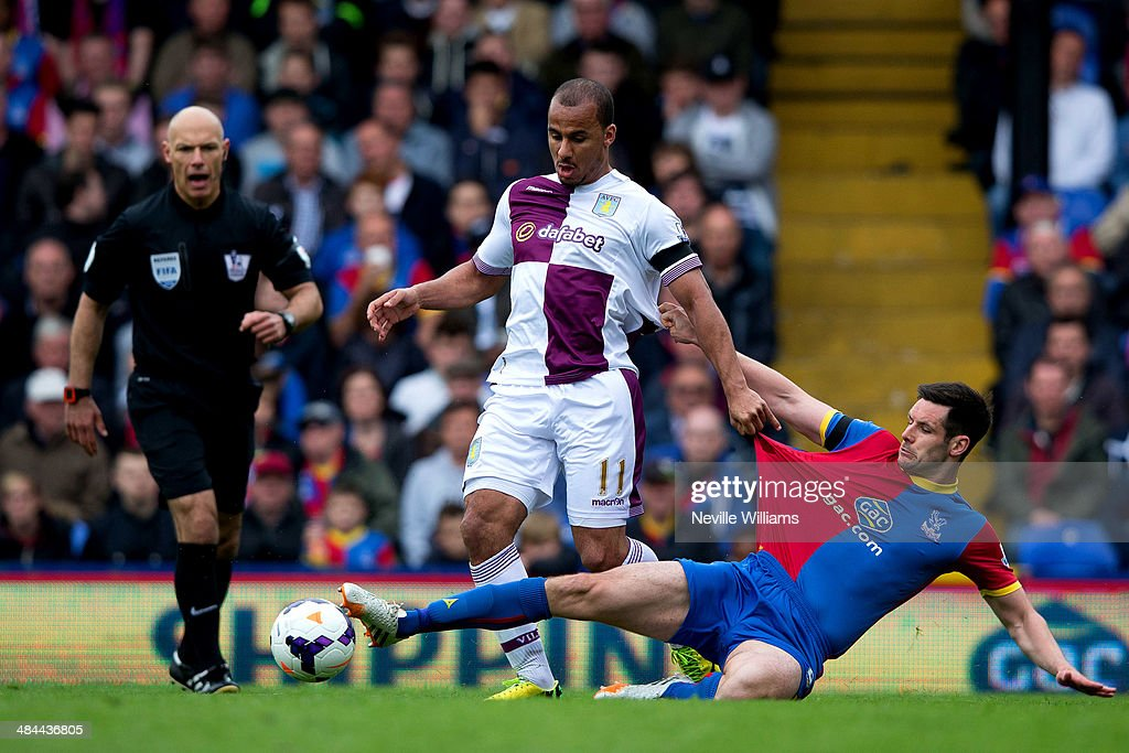 Gabriel Agbonlahor of Aston Villa is challenged by Scott Dann of Crystal Palace during the Barclays Premier League match between Crystal Palace and Aston Villa at Selhurst Park on April 12, 2014 in London, England.