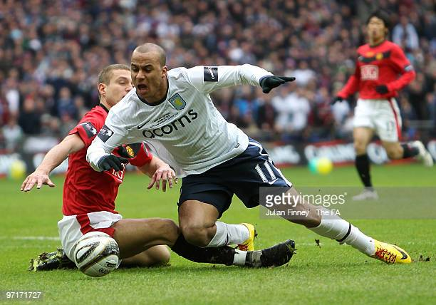 Gabriel Agbonlahor of Aston Villa is fouled by Nemanja Vidic of Manchester United to give away a penalty during the Carling Cup Final between Aston...