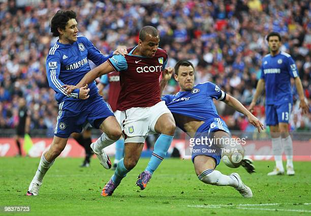Gabriel Agbonlahor of Aston Villa is tackled by John Terry of Chelsea during the FA Cup sponsored by E.ON Semi Final match between Aston Villa and...