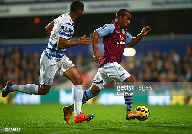 Gabriel Agbonlahor of Aston Villa is tracked by Steven Caulker of QPR during the Barclays Premier League match between Queens Park Rangers and Aston...