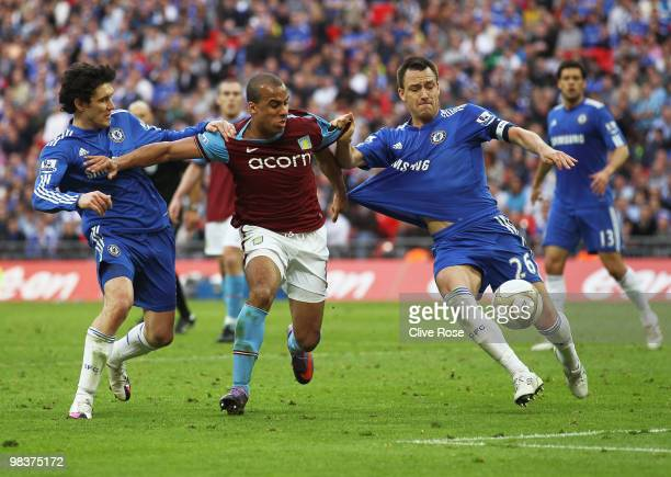 Gabriel Agbonlahor of Aston Villa pulls the shirt of John Terry of Chelsea as he is closed down by Yuri Zhirkov during the FA Cup sponsored by E.ON...