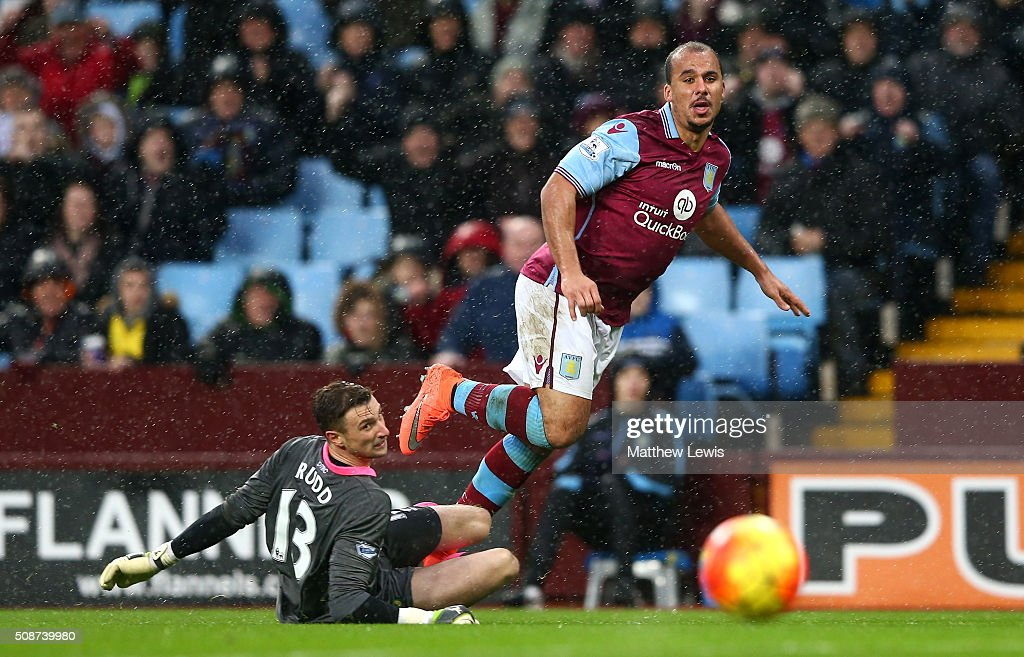 Gabriel Agbonlahor of Aston Villa scores his team's second goal past Declan Rudd of Norwich City during the Barclays Premier League match between Aston Villa and Norwich City at Villa Park on February 6, 2016 in Birmingham, England.