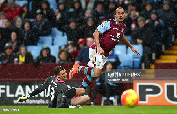 Gabriel Agbonlahor of Aston Villa scores his team's second goal past Declan Rudd of Norwich City during the Barclays Premier League match between...