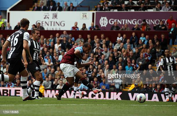 Gabriel Agbonlahor of Aston Villa scores the first goal during the Barclays Premier League match between Aston Villa and Newcastle United at Villa...