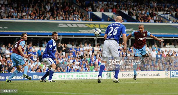 Gabriel Agbonlahor of Aston Villa scores the first goal during the Barclays Premier League match between Birmingham City and Aston Villa at St...