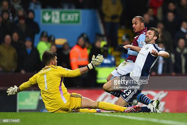 Gabriel Agbonlahor of Aston Villa scores the opening goal under pressure from Gareth McAuley and Ben Foster of West Brom during the Barclays Premier...