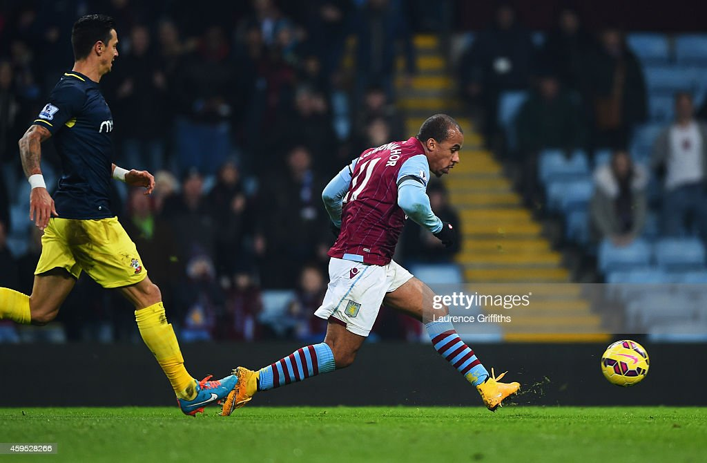 Gabriel Agbonlahor of Aston Villa (R) scores their first goal during the Barclays Premier League match between Aston Villa and Southampton at Villa Park on November 24, 2014 in Birmingham, England.