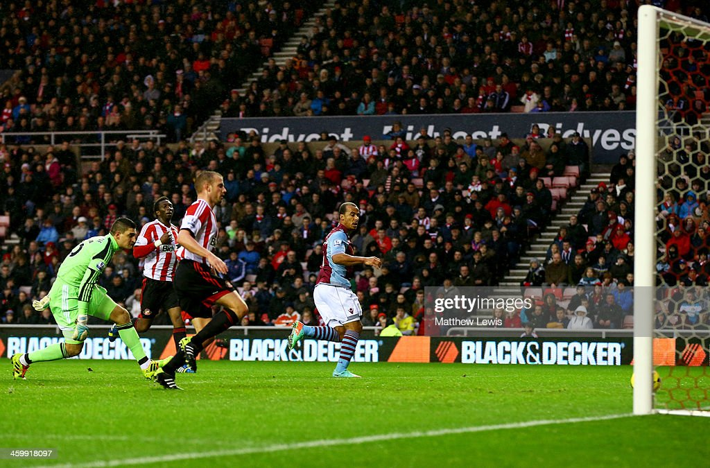 Gabriel Agbonlahor of Aston Villa (R) scores their first goal during the Barclays Premier League match between Sunderland and Aston Villa at Stadium of Light on January 1, 2014 in Sunderland, England.