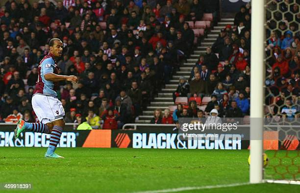 Gabriel Agbonlahor of Aston Villa scores their first goal during the Barclays Premier League match between Sunderland and Aston Villa at Stadium of...