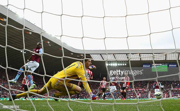Gabriel Agbonlahor of Aston Villa scores their second goal past Costel Pantilimon of Sunderland during the Barclays Premier League match between...