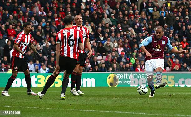 Gabriel Agbonlahor of Aston Villa scores their third goal during the Barclays Premier League match between Sunderland and Aston Villa at Stadium of...