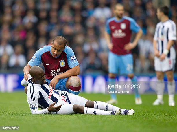 Gabriel Agbonlahor of Aston Villa talks with Youssouf Mulumbu of West Bromwich Albion during the Barclays Premier League match between West Bromwich...