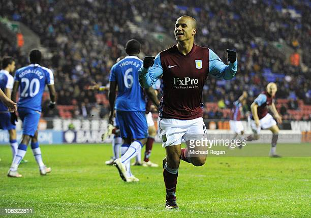Gabriel Agbonlahor of Villa celebrates scoring the first goal during the Barclays Premier League match between Wigan Athletic and Aston Villa at the...
