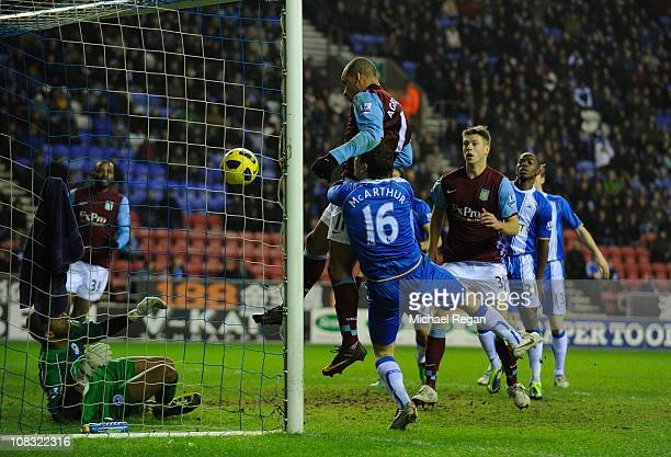 Gabriel Agbonlahor of Villa scores the first goal during the Barclays Premier League match between Wigan Athletic and Aston Villa at the DW Stadium...