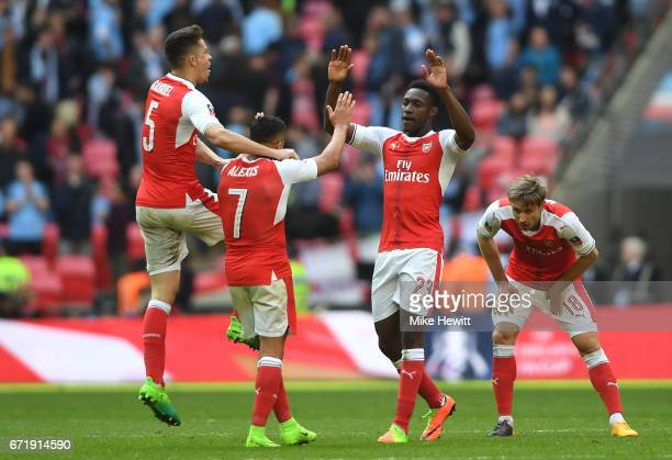 Gabriel Alexis Sanchez Danny Welbeck and Nacho Monreal of Arsenal celebrate their 21 victory after the Emirates FA Cup SemiFinal match between...