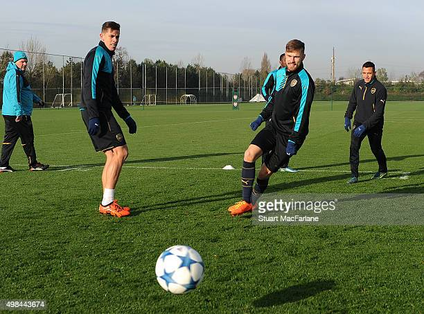 Gabriel and Aaron Ramsey of Arsenal during a training session at London Colney on November 23 2015 in St Albans England