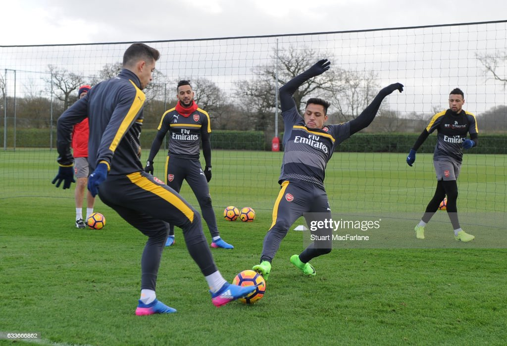 Gabriel and Alexis Sanchez of Arsenal during a training session at London Colney on February 3, 2017 in St Albans, England.