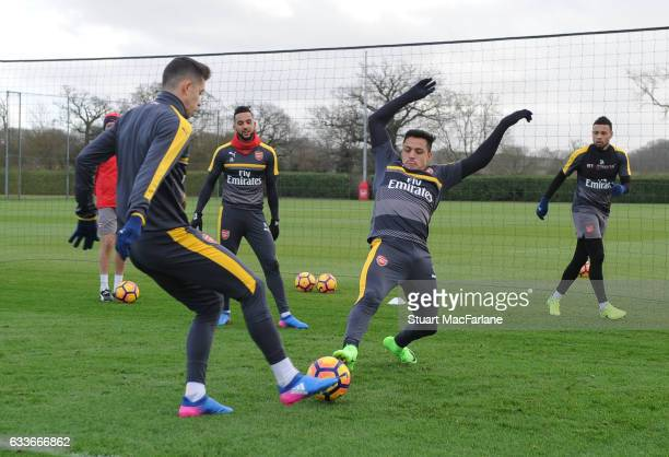 Gabriel and Alexis Sanchez of Arsenal during a training session at London Colney on February 3 2017 in St Albans England