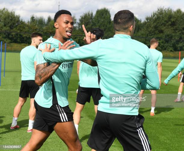 Gabriel and Granit Xhaka of Arsenal during a training session at London Colney on September 17, 2021 in St Albans, England.