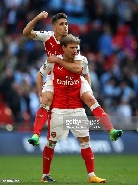 Gabriel and Nacho Monreal of Arsenal celebrate their 2-1 victory after the Emirates FA Cup Semi-Final match between Arsenal and Manchester City at...