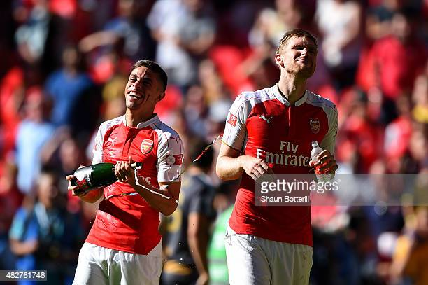 Gabriel and Per Mertesacker of Arsenal celebrate their team's 10 win in the FA Community Shield match between Chelsea and Arsenal at Wembley Stadium...