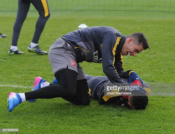Gabriel and Theo Walcott of Arsenal during a training session at London Colney on January 27 2017 in St Albans England