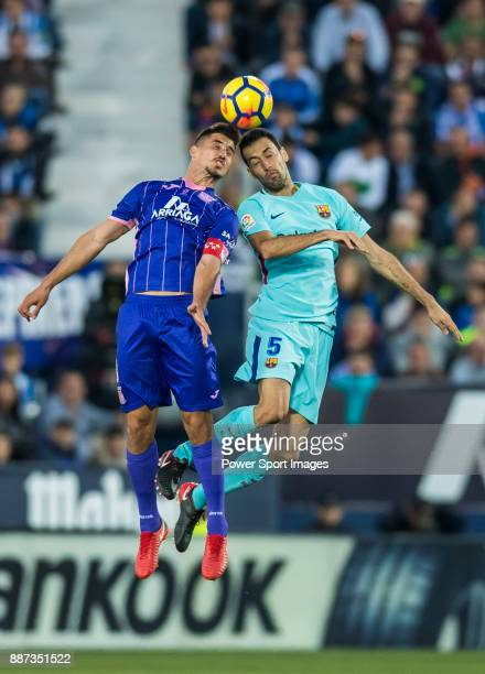 Gabriel Appelt Pires of CD Leganes battles for the ball with Sergio Busquets Burgos of FC Barcelona during the La Liga 201718 match between CD...