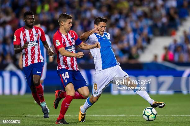 Gabriel Appelt Pires of CD Leganes fights for the ball with Gabriel Fernandez Arenas Gabi of Atletico de Madrid during the La Liga 201718 match...