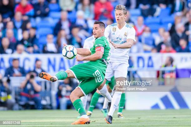 Gabriel Appelt Pires of CD Leganes fights for the ball with Marcos Llorente of Real Madrid during the La Liga 201718 match between Real Madrid and CD...