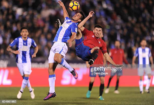 Gabriel Appelt Pires of CD Leganes is tackled by David Garcia of CA Osasuna during the La Liga match between CD Leganes and CA Osasuna at Estadio...