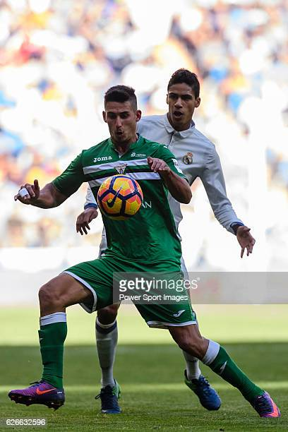 Gabriel Appelt Pires of Deportivo Leganes fights for the ball with Raphael Varane of Real Madrid during their La Liga match between Real Madrid and...