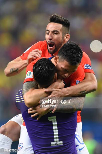 Gabriel Arias of Chile celebrates winning with teammates Mauricio Isla and Charles Aranguiz in a penalty shootout after the Copa America Brazil 2019...