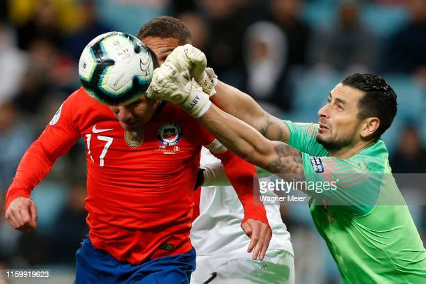 Gabriel Arias of Chile clears the ball as teammate Gary Medel attempts a header during the Copa America Brazil 2019 Semi Final match between Chile...