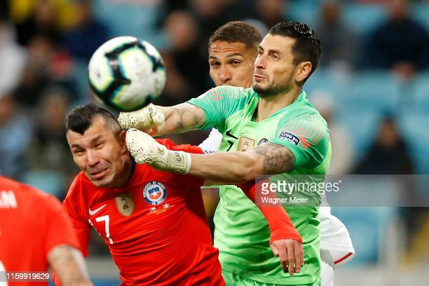 Gabriel Arias of Chile clears the ball as teammate Gary Medel attempts a header against Paolo Guerrero of Peru during the Copa America Brazil 2019...