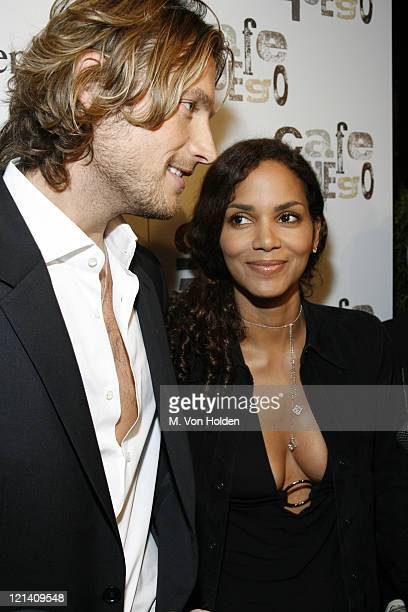 Gabriel Aubry and Halle Berry during Hennessy Cognac Hosts an Exclusive Tasting at Café Fuego November 14 2006 at Cafe Fuego in New York City New...