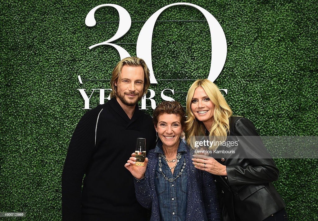 Gabriel Aubry (L) and Heidi Klum (R) attend the Glamour and INC International Concepts Denim Dash with Heidi Klum at Herald Square on October 30, 2015 in New York City.
